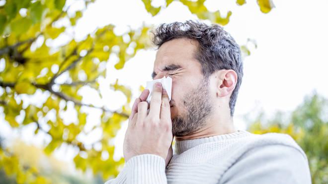 Man sneezing generic