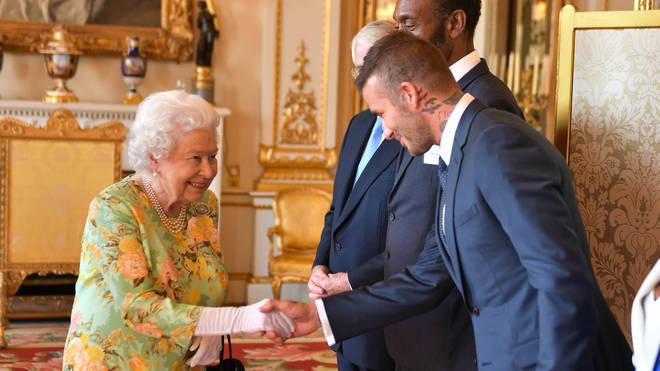 The Queen meets David Beckham at Buckingham Palace
