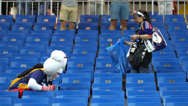 Japan fans clean up stadium