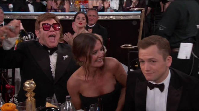 Elton cheering on Taron
