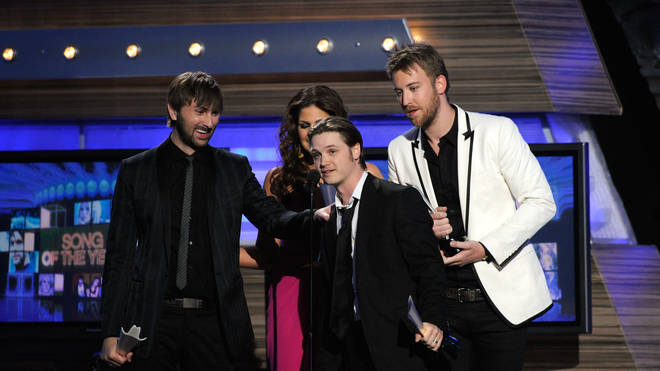 Josh Kear (in front) with Lady Antebellum after winning Song of the Year in 2010
