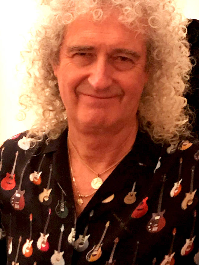 Brian May promoting his new shirt design – the same featured on bras and waistcoats