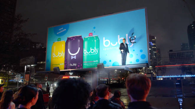 Michael Bublé in front of the billboard