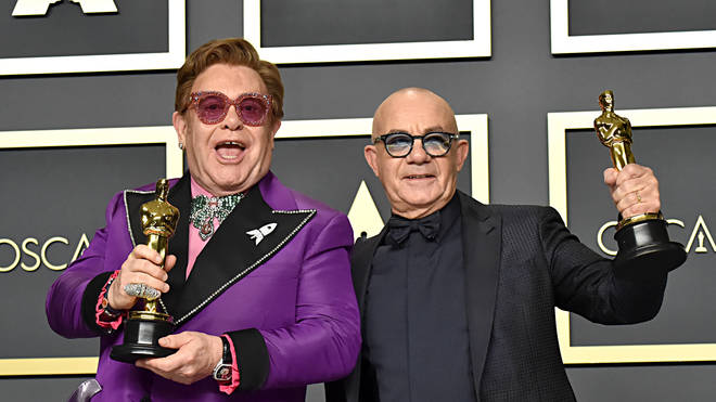 Elton John and Bernie Taupin with their Oscars