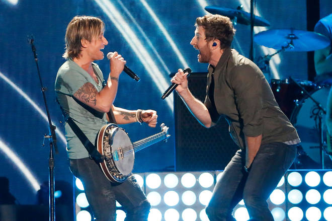 Keith Urban performing with Brett Eldredge