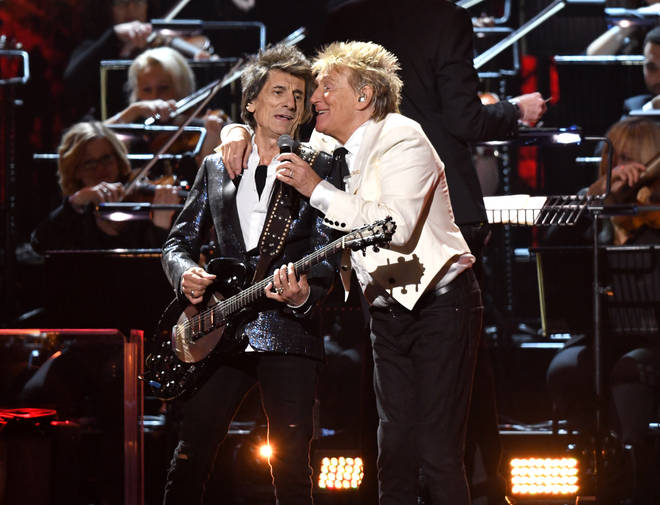 Rod Stewart and Ronnie Wood perform on stage at the BRITs 2020