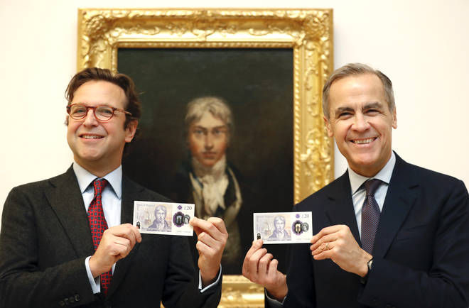 Director of Tate Britain Alex Farquharson and Governor of The Bank of England Mark Carney display the new £20 pound note in front of a self portrait of JMW Turner