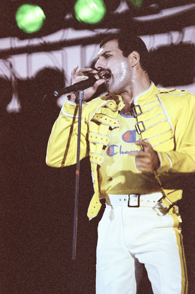 Freddie Mercury performing live on stage at Knebworth on August 9, 1991