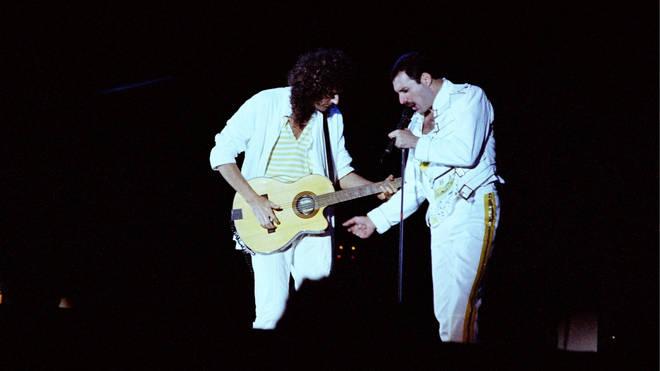 Brian May and Freddie Mercury performing live on stage at Knebworth Park