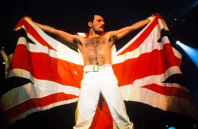 Freddie Mercury holding a union jack flag at the end of the August 9 concert