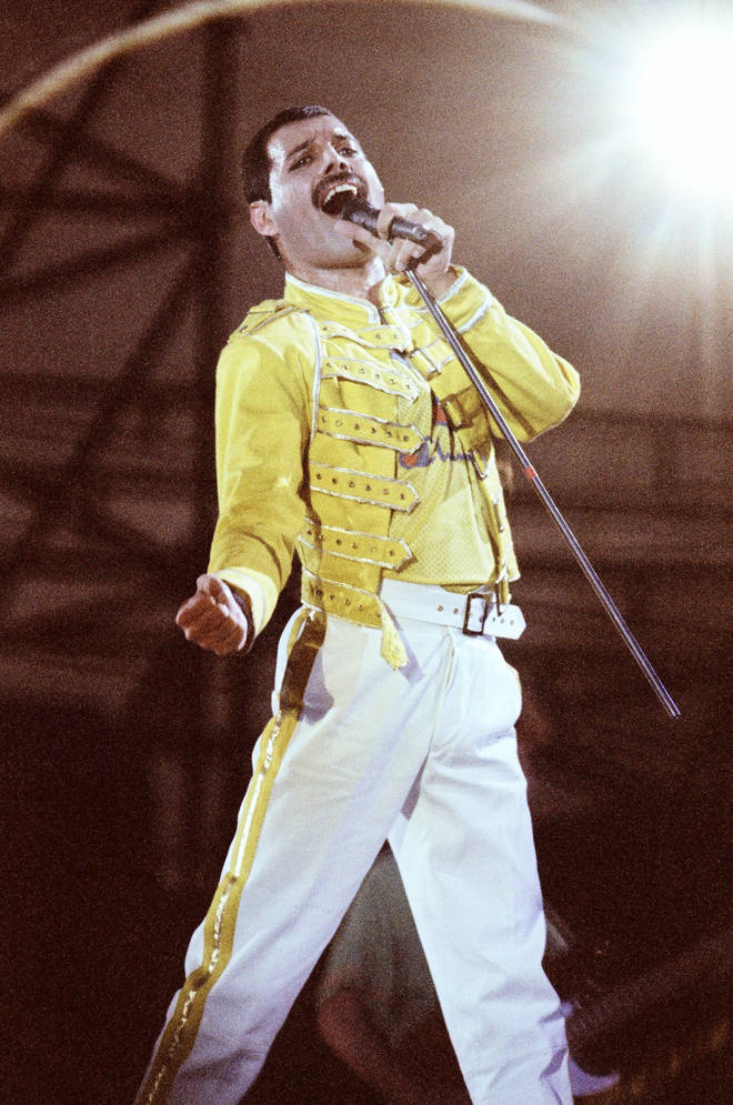 Freddie Mercury performing on stage in front of the 120,000 strong crowd at Knebworth Park August 9, 1986