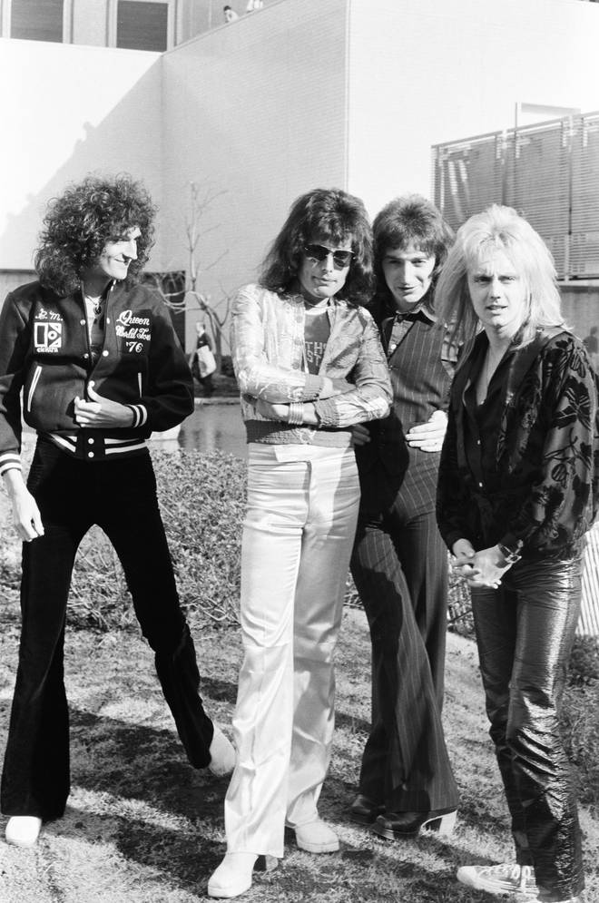 Photo session for 'Music Life' magazine, in the garden of Hotel Pacific Tokyo on their Night At The Opera Japan tour, Tokyo, Japan, 21 March 1976. L-R Brian May, Freddie Mercury, John Deacon, Roger Taylor.