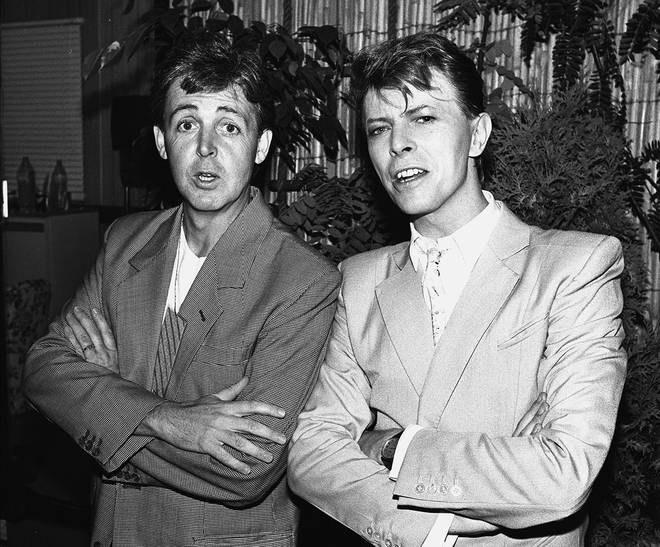 David Bowie posing with Paul McCartney backstage at Live Aid on 13th July, 1985.