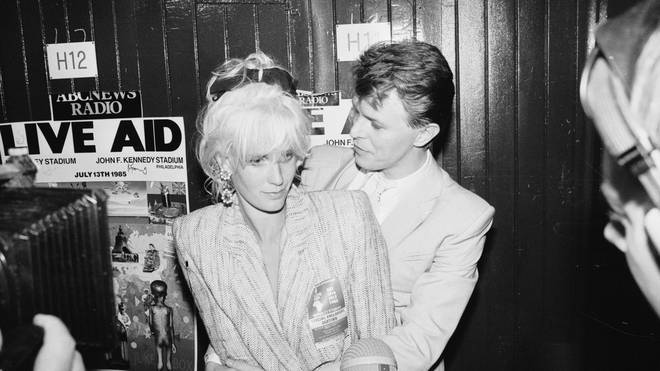 David Bowie and Paula Yates at the Live Aid concert at Wembley Stadium, London, 13th July 1985.
