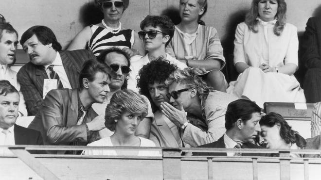 Bob Geldof has a word with Prince Charles, while David Bowie chats with Roger Taylor and Brian May of Queen, during the Live Aid Concert at Wembley Stadium, 13th July 1985.