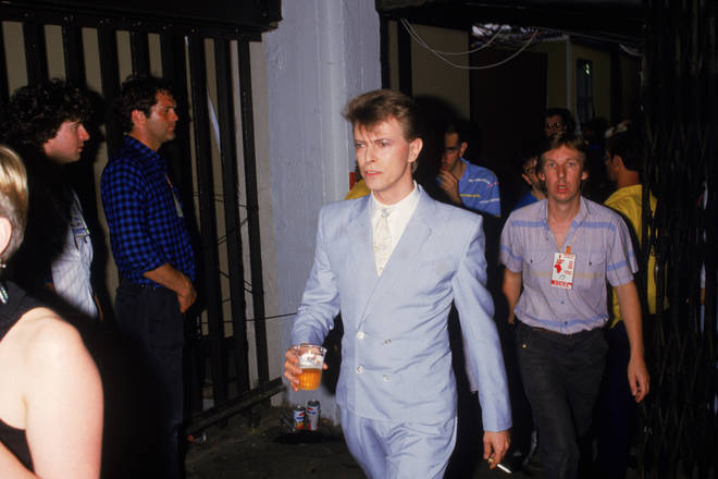 David Bowie hold a beer backstage at the Live Aid charity concert, Wembley Stadium, London, 13th July 1985.