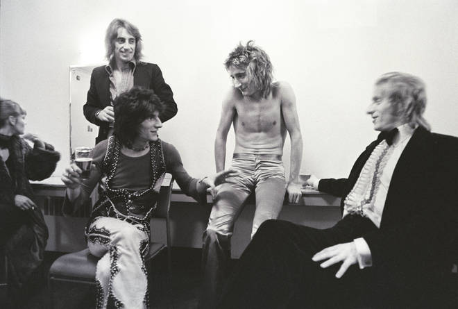 Rod Stewart and Faces pictured backstage with footballer Dennis Law in 1975.