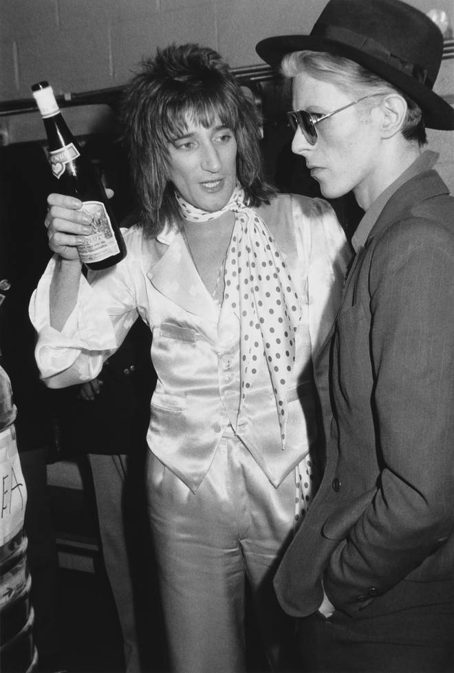 Rod Stewart talks with David Bowie backstage on February 24, 1975 at Madison Square Garden, where Stewart performed.