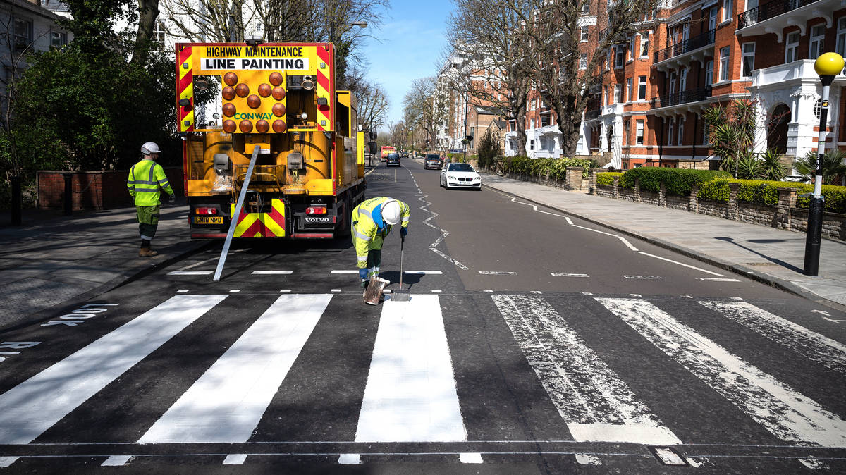 Abbey Road's iconic Beatles zebra crossing is finally repainted as no-one's currently using it