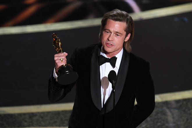 Brad Pitt accepts the Actor in a Supporting Role award for 'Once Upon a Time...in Hollywood' onstage during the 92nd Annual Academy Awards at Dolby Theatre on February 09, 2020