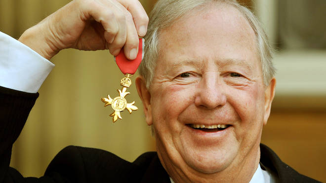 Tim Brooke-Taylor with his OBE in 2011