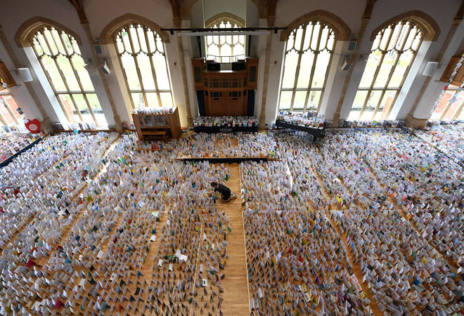 Colonel Tom has been sent over 120,000 birthday cards - enough to fill an entire school hall (pictured) - to celebrate his 100th birthday