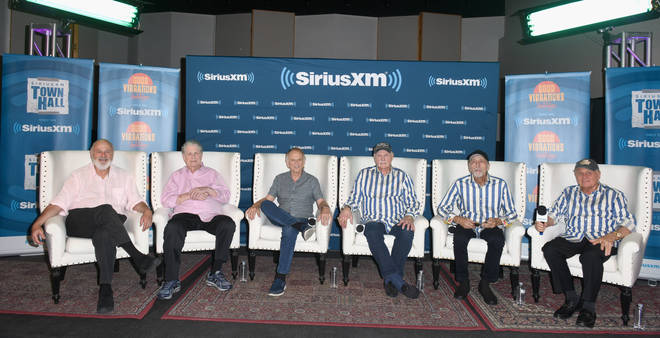 Host Rob Reiner, Brian Wilson, Al Jardine, Mike Love, David Marks and Bruce Johnston of The Beach Boys speak onstage together in July 2018 in Hollywood, California