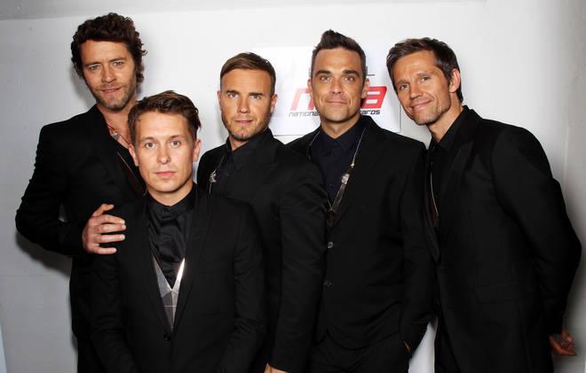 L-R Howard Donald, Mark Owen, Gary Barlow, Robbie Williams and Jason Orange of Take That in 2011
