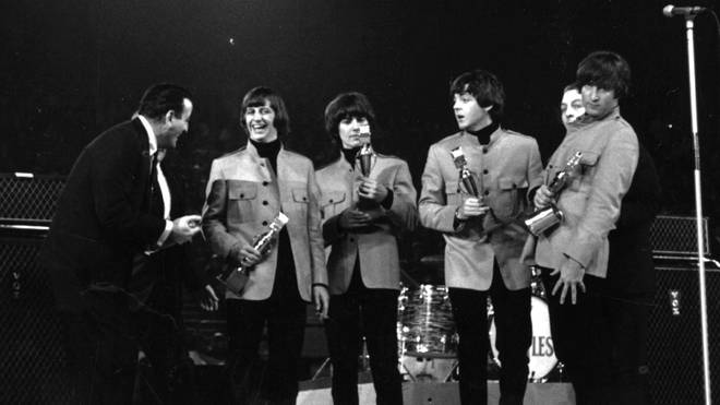 Tony Bennett presenting an award to The Beatles at the New Musical Express Poll Winners' Concert at Wembley, London, in 1965