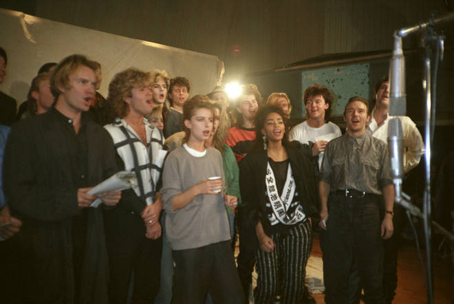 Sting, George Michael and Paul Young photographer rehearsing with other stars for Band Aid, November 1984