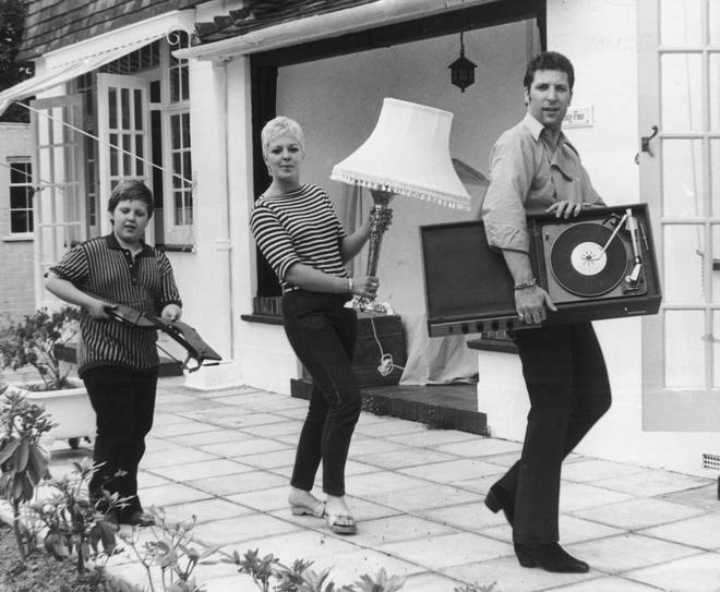 Tom Jones, wife Linda and son Mark, moving into their new home Sunbury in Surrey, 21st July 1967.