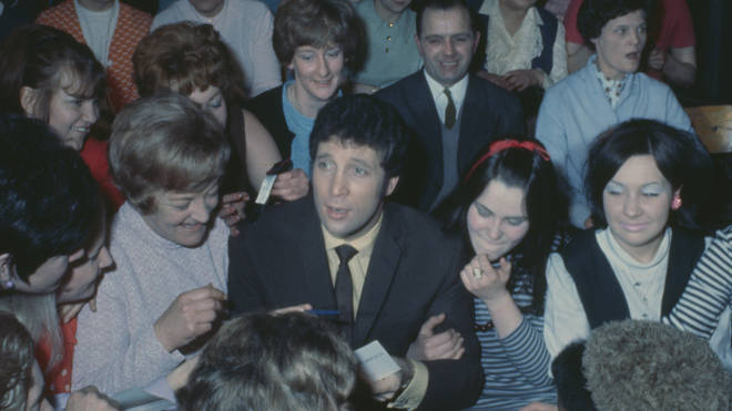 Tom Jones surrounded by female fans at a screening of TV show 'This Is Tom Jones' in 1969