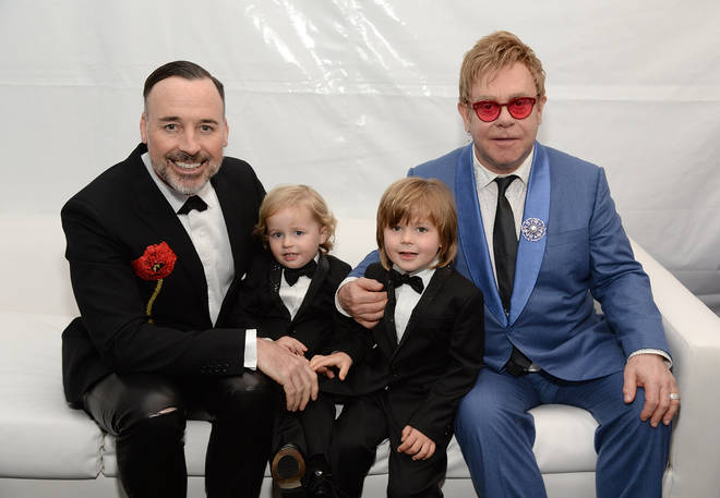 David Furnish, Elijah Furnish-John, Zachary Furnish-John, and Sir Elton John attend the 23rd Annual Elton John AIDS Foundation Academy Awards Viewing Party on February 22, 2015 in Los Angeles, California