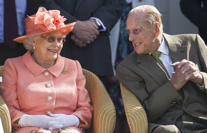 Queen Elizabeth II and Prince Philip, Duke of Edinburgh attend The OUT-SOURCING Inc Royal Windsor Cup 2018 polo match at Guards Polo Club on June 24, 2018