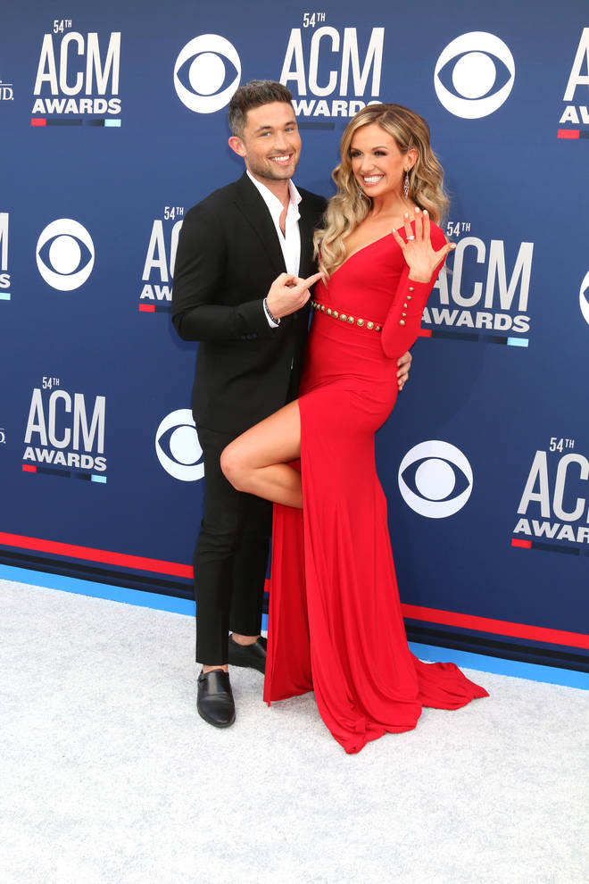 Michael Ray and Carly Pearce showing off their engagement at the ACM Awards