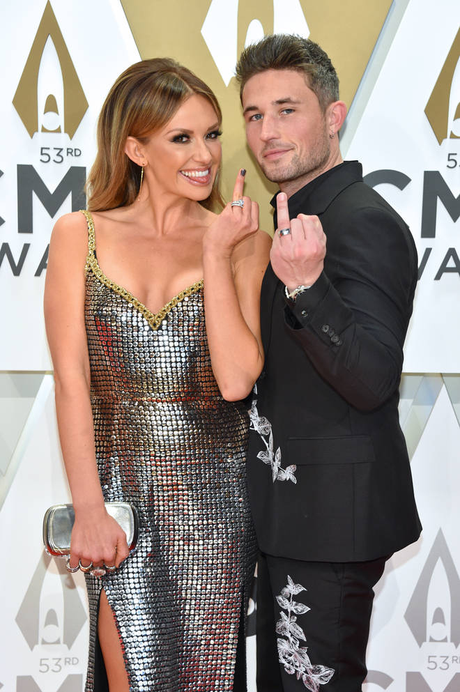 Carly Pearce and Michael Ray show off their wedding bands at the CMAs