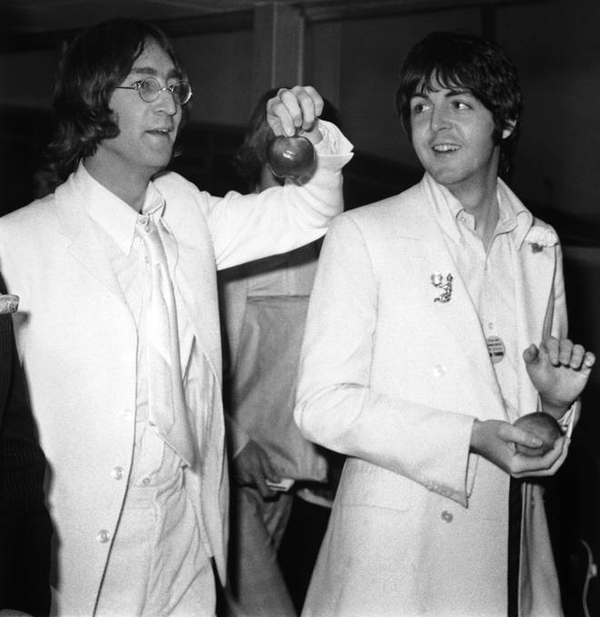 John Lennon and Paul McCartney at London Airport after a trip to America to promote their new company Apple Corps, 16th May 1968.