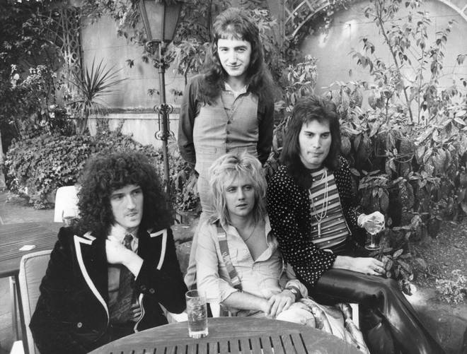 Queen, from left to right; Brian May, John Deacon (standing), Roger Taylor and Freddie Mercury