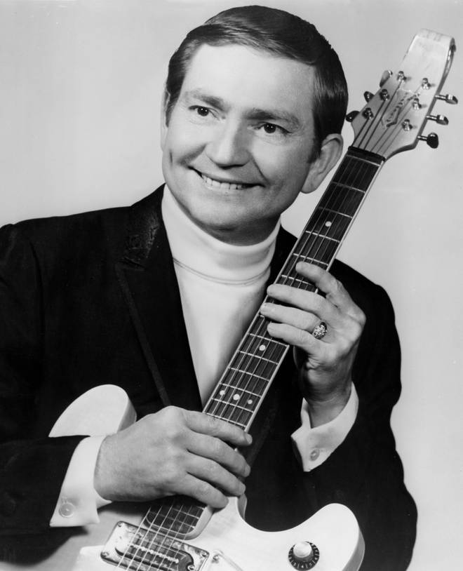 Willie Nelson poses for a portrait with an electric guitar in 1967
