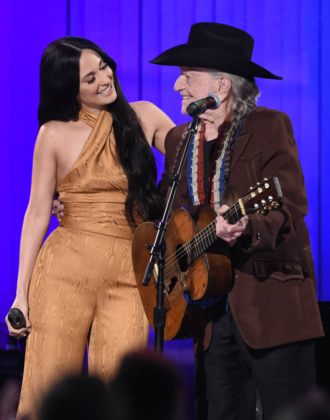 Kacey Musgraves performing with Willie Nelson at the 52nd Annual Country Music Association Awards in 2019