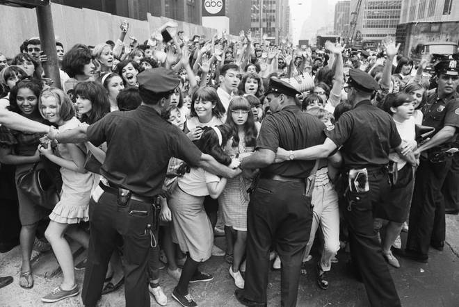 The performance came at the height of Beatlemania. Pictured, police hold back fans from crashing into the Warwick Hotel, the Beatles' New York residence