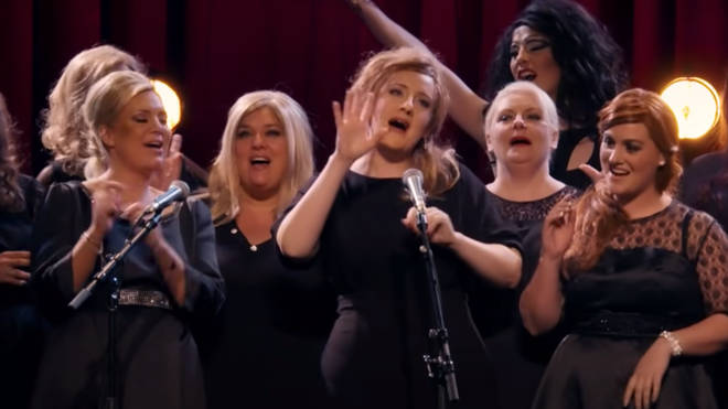 Once the secret is out, Adele is joined on stage by her impersonators to sing as a group
