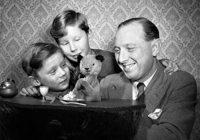 Harry Corbett with Sooty and sons David, 9, on the left, and Peter (better known as Matthew Corbett), aged 6, on the right.