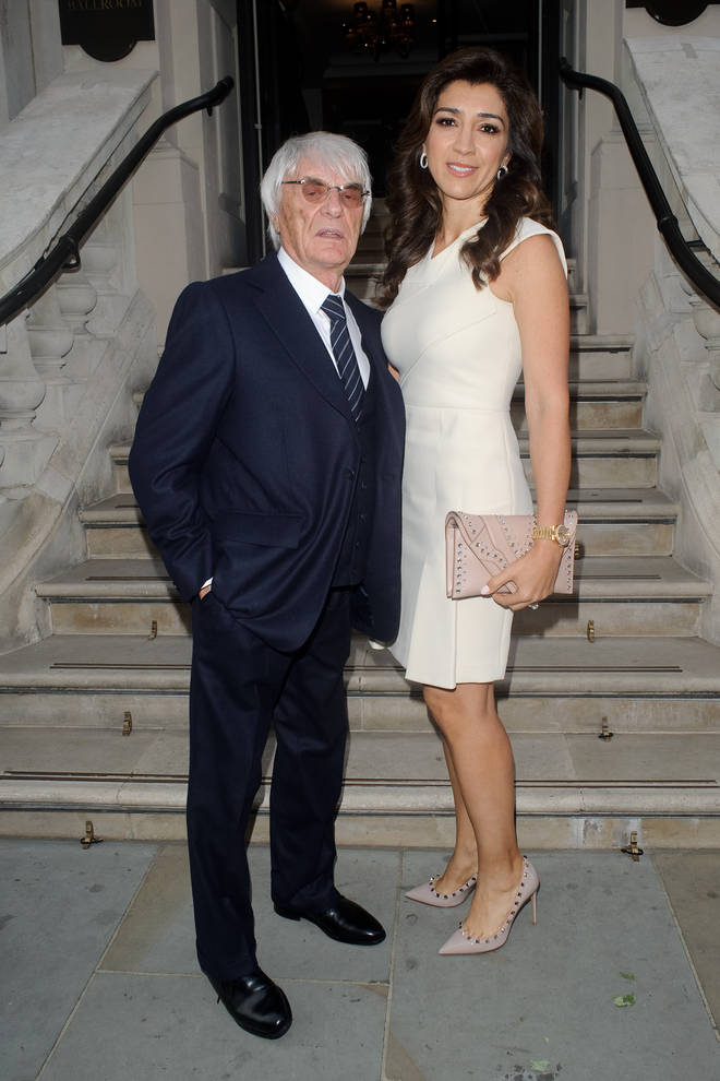 Bernie Ecclestone and Fabiana Flosi arriving at the Petra Stunt fundraiser at the Corinthia hotel on June 19, 2017 in London, England.