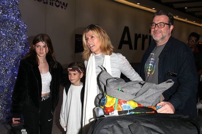 Kate Garraway with her husband Derek Draper, and children Darcey Draper and William Draper arrive at Heathrow Airport after returning from 'I'm A Celebrity... Get Me Out Of Here!' on December 11, 2019 in London