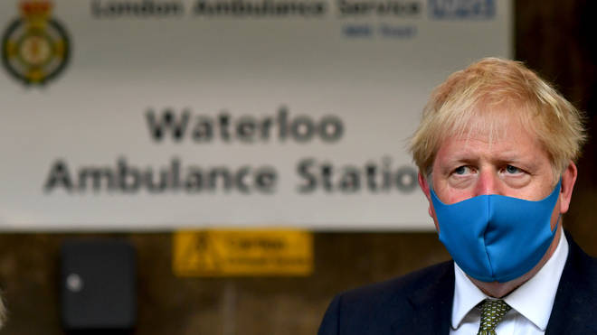 Boris Johnson wears a face mask during his visit to the headquarters of the London Ambulance Service NHS Trust on July 13, 2020 in London