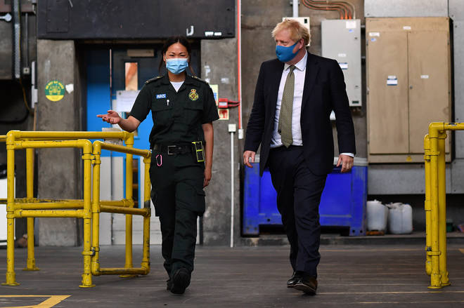 Boris Johnson wears a face mask to visit the headquarters of the London Ambulance Service NHS Trust on July 13, 2020 in London