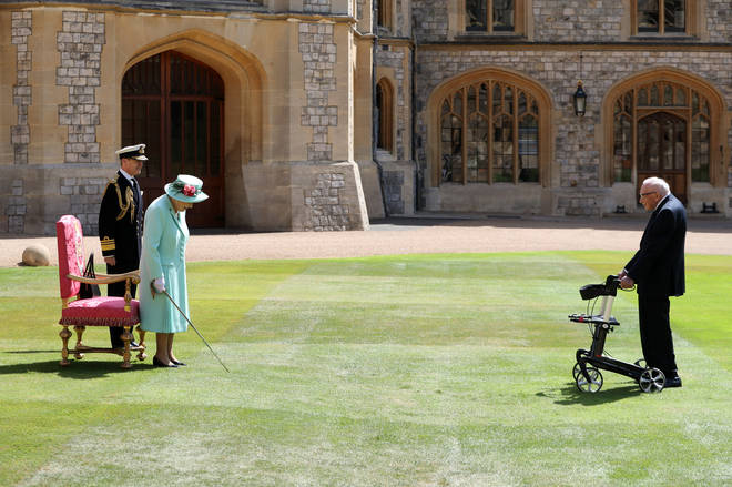 Captain Tom makes his way across the courtyard of Windsor Castle to meet the Queen