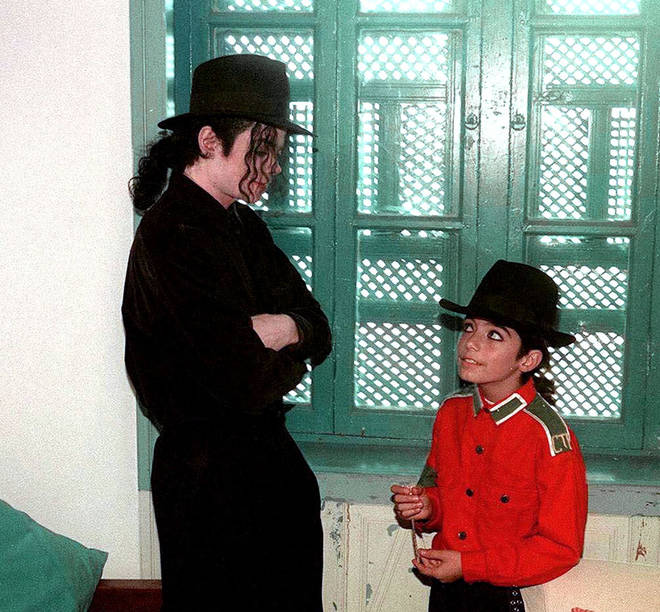 Omer Bhatti and Paris Jackson consider themselves brother and sister since birth. Pictured, Omer with Michael Jackson