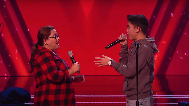 Joshua Regala, 14, and his mum Ysan perform on stage